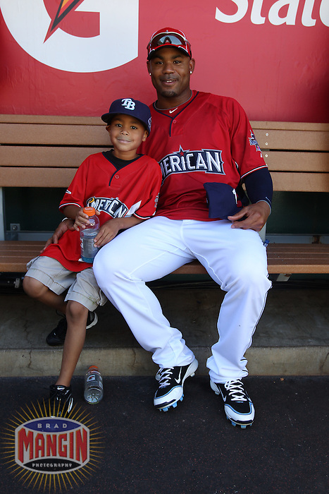 ANAHEIM - JULY 12:  Carl Crawford of the American League and his son sit for a portrait in the dugout before the Home Run Derby during All Star Game festivities at Angel Stadium on June 12, 2010 in Anaheim, California. Photo by Brad Mangin