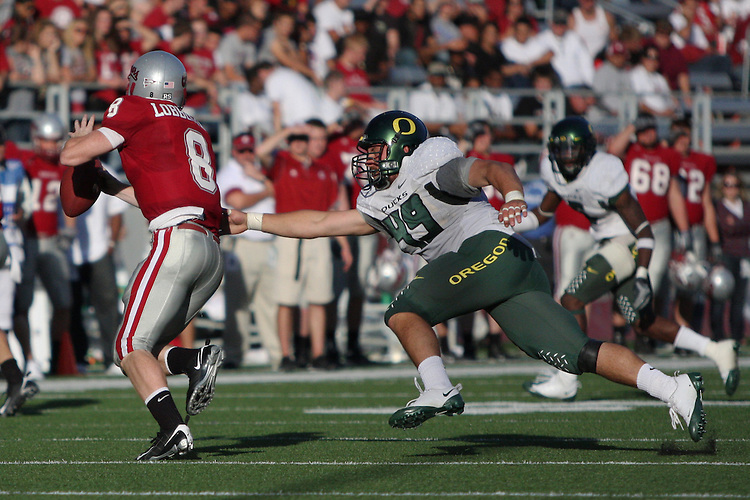 Oregon defensive end, Nick Reed (#49), chases down Cougar quarterback, Marshall Lobbestael (#8), during the Ducks Pac-10 conference game against the Washington State at Martin Stadium in Pullman, Washington, on September 27, 2008.