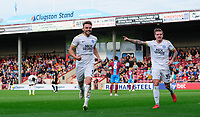 Peterborough United's Matthew Godden, left, celebrates scoring his side's second goal with team-mate Jason Cummings<br /> <br /> Photographer Chris Vaughan/CameraSport<br /> <br /> The EFL Sky Bet League One - Scunthorpe United v Peterborough United - Saturday 13th October 2018 - Glanford Park - Scunthorpe<br /> <br /> World Copyright © 2018 CameraSport. All rights reserved. 43 Linden Ave. Countesthorpe. Leicester. England. LE8 5PG - Tel: +44 (0) 116 277 4147 - admin@camerasport.com - www.camerasport.com