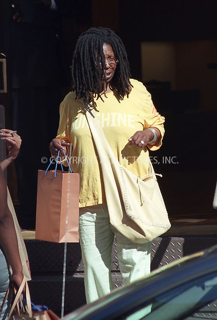 ***EXCLUSIVE***..In case you did not know -- actress Whoopi Goldberg seems to be quite a heavy smoker. Casually dressed Whoopi and her friends checked several boutiques in SoHo this weekend. Whoopi just kept liting up that cigarette every time she was walking out of the shop. New York. August 2002. ..Please byline: Alecsey Boldeskul/NY Photo Press.   ..*PAY-PER-USE*      ....NY Photo Press:  ..phone (646) 267-6913;   ..e-mail: info@nyphotopress.com