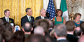 United States President Barack Obama hosts a St. Patrick's Day reception attended by Prime Minister Enda Kenny of Ireland in the East Room of the White House in Washington, D.C. on Friday, March 14, 2014. From left to right: Prime Minister Enda Kenny of Ireland, President Obama, U.S. Vice President Joe Biden, first lady Michelle Obama, and Fionnuala O'Kelly, wife of Prime Minister Kenny.<br /> Credit: Ron Sachs / Pool via CNP