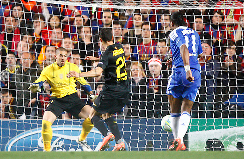 18.04.2012. Stamford Bridge, Chelsea, London. Chelsea's Ivory Coast footballer Didier Drogba scores for Chelsea during the Champions League Semi Final 1st  leg match between Chelsea and Barcelona  at Stamford Bridge, Stadium on April 18, 2012 in London, England.............