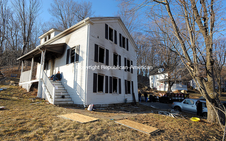 WINSTED  CT, 19 FEBRUARY  2012-021912JS01-An early morning fire heavily damaged a home at 133 Spencer Street in Winsted on Sunday and the home may be a total loss. Officials were investigating to determine the cause of the fire. .Jim Shannon Republican-American