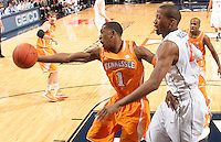 Tennessee guard Josh Richardson (1) reaches for the ball next to Virginia forward Akil Mitchell (25) during the game Wednesday in Charlottesville, VA. Virginia defeated Tennessee 46-38.