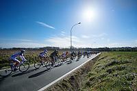 peloton kicking off the Spring Classics season under a clear blue sky<br /> <br /> Omloop Het Nieuwsblad 2015