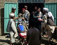 Foot soldiers from the Wardak Mobile Patrol Unit take their bikes to a mechanic to have their bikes serviced. the mechanics are mobile and can move out to combat positions to service bikes in the field if needed