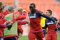 Washington, D.C.- March 29, 2014. Jhon Kennedy Hurtado of the Chicago Fire celebrates with teammates his score.  The Chicago Fire tied D.C. United 2-2 during a Major League Soccer Match for the 2014 season at RFK Stadium.