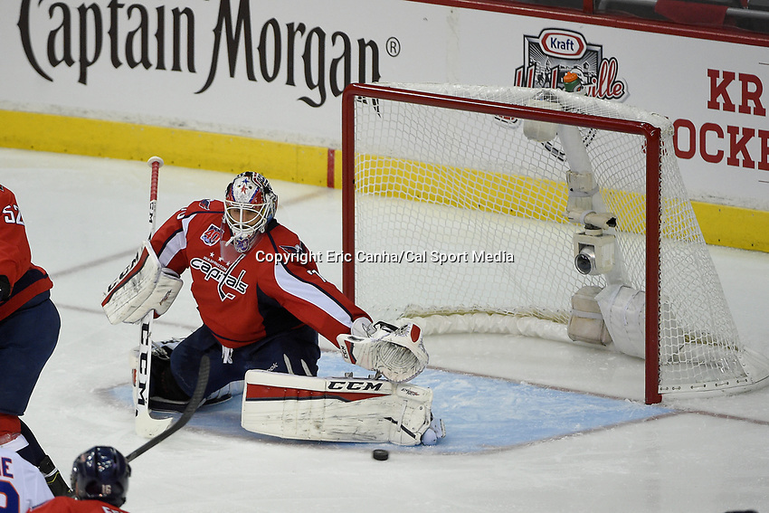 April 15, 2015 - Washington D.C., U.S. - Washington Capitals goalie Braden Holtby (70) reaches out to make a save during game 1 of the  NHL Eastern Conference Quarter finals between the New York Islanders and the Washington Capitals held at the Verizon Center in Washington D.C. Eric Canha/CSM