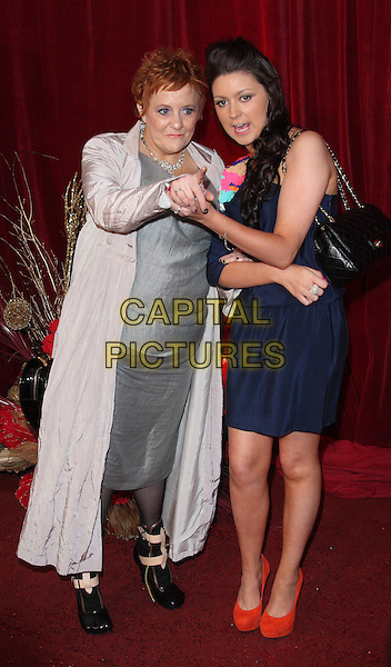 GUEST & MADELINE DUGGAN.British Soap Awards 2010 at the London ITV Studios, South Bank, London, England..May 8th 2010.arrivals full length black  blue dress silver grey gray red shoes hand pointing .CAP/ROS.©Steve Ross/Capital Pictures.