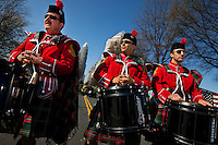 Members of the Charlotte Fire Department Pipes and Drum Band await their que, prior to the start of the annual St. Patrick's Day Parade in Uptown/Downtown Charlotte, North Carolina.