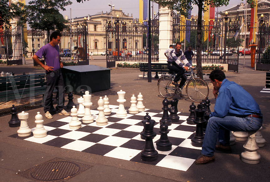 chess, game, Geneva, Switzerland, Men playing a game of chess on a giant chessboard at the Promenade des Bastions in the city of Geneva.