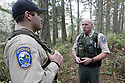Dec 1, 2015:  Fish and Wild Life officer Bryan Davidson (right) and fellow officer Cory Bronscomb (left) walked the Anderson Lake trails in Port Townsend, WA looking for signs of anything out of the ordinary.