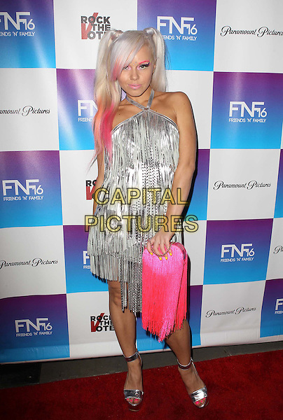 Kerli Koiv .Paramount Studios' 16th Annual Friends 'N' Family Party Held At Paramount Studios, Los Angeles, California,.USA, 8th February 2013..full length pink silver fringed tassels dress halterneck bag bunches streak hair dyed .CAP/ADM/KB.©Kevan Brooks/AdMedia/Capital Pictures.