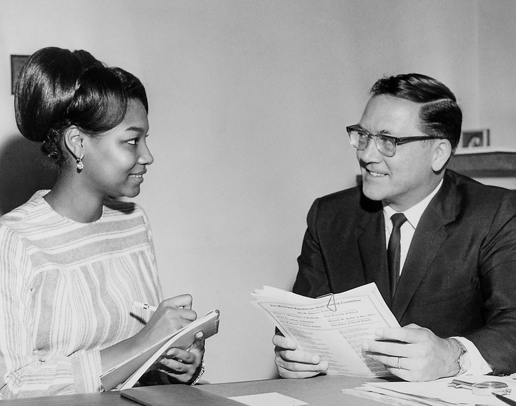 Sen. Robert P. Griffin, R-Mich. with Annette Abrams, receptionist. (Photo by CQ Roll Call)
