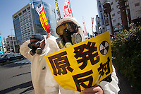 Japanese people march for workers' rights and to protest against Prime Minister Shinzo Abe's nuclear policies during the May Day Rally in Tokyo, Japan. Friday May 1st 2015
