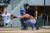 Durham Bulls catcher Mike Marjama (3) sets a target as home plate umpire Brian Peterson looks on during the game against the Charlotte Knights at BB&T BallPark on May 16, 2017 in Charlotte, North Carolina.  The Knights defeated the Bulls 5-3. (Brian Westerholt/Four Seam Images)