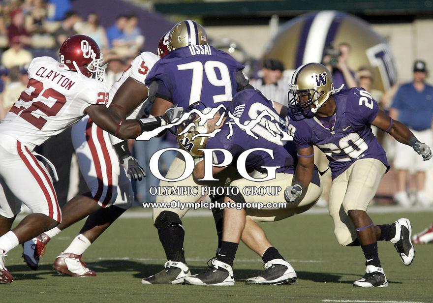 Sept 13, 2008:   Oklahoma linebacker #22 Keenan Clayton face masks Washington Huskies quarterback #10 Jake Locker.  Clayton was called for a face mask penalty allowing the Huskies a first down.  Oklahoma won 55-14 over the Washington Huskies at Husky Stadium in Seattle, Washington.