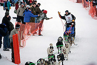 Norwegian Kjetil Backen gives a high five at the restart of the 2008 Iditarod in Willow