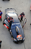 Jun. 29, 2012; Joliet, IL, USA: Crew members move the car of NHRA pro stock driver Erica Enders during qualifying for the Route 66 Nationals at Route 66 Raceway. Mandatory Credit: Mark J. Rebilas-