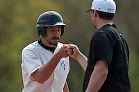25 April 2010: Benjamin Deruelle of the PUC is congratulated by Ian Young during game 1/week 3 of the French Elite season won 12-4 by Rouen over the PUC, at the Pershing Stadium in Vincennes, near Paris, France.