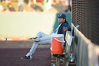 Tri-City Dust Devils pitcher Diomar Lopez (31) sits on the bench in the bullpen during a Northwest League game against the Everett AquaSox at Everett Memorial Stadium on September 3, 2018 in Everett, Washington. The Everett AquaSox defeated the Tri-City Dust Devils by a score of 8-3. (Zachary Lucy/Four Seam Images)