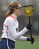 Kelly Trotta #30 of Manhasset carries downfield during a Nassau County varsity girls lacrosse game against Massapequa at Manhasset High School on Tuesday, March 27, 2018. She tallied three goals and an assist in Manhasset's 11-8 win.