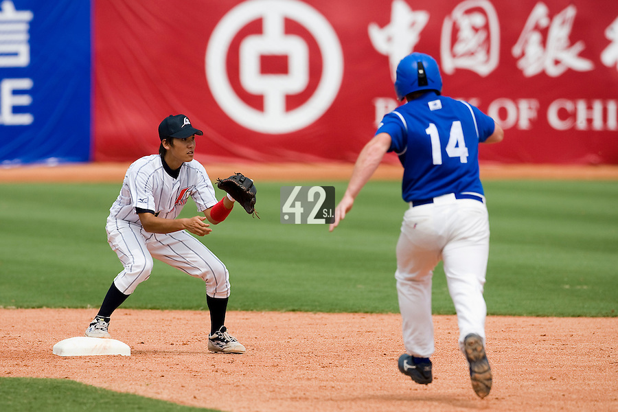 22 August 2007: Japanese baseball team's player Hayato Sakamoto catches a ball before France's player David Gauthier touches the second base during the Japan 9-4 victory over France in the Good Luck Beijing International baseball tournament (olympic test event) at west Beijng's Wukesong Baseball Field in Beijing, China.