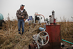 Brett Oelke inspects the pump for a center pivot irrigation system on his family's 6,000-acre farm outside of Hoxie, Kan., on Friday, Oct. 12, 2012. As historically dry conditions continue, farmers from South Dakota to the Texas panhandle rely on the Ogallala Aquifer, the largest underground aquifer in the United States, to irrigate crops. After decades of use, the falling water level ? accelerated by historic drought conditions over the last two years ? is putting pressure on farmers to ease usage or risk becoming the last generation to grow crops on the land. Farmers like Mitchell Baalman (not pictured) and Brett Oelke are part of a farming community in in Sheridan County, Kansas, an agricultural hub in western Kansas, who have agreed to cut back on water use for crop irrigation so that their children and future generations can continue to farm and sustain themselves on the High Plains.