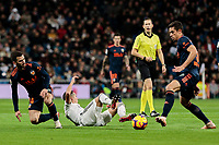 Real Madrid's -17- and Valencia CF's Jose Gaya fight for the ball during La Liga match between Real Madrid and Valencia CF at Santiago Bernabeu Stadium in Madrid, Spain. December 01, 2018. (ALTERPHOTOS/A. Perez Meca) /NortePhoto NORTEPHOTOMEXICO