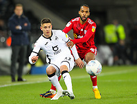 29th November 2019; Liberty Stadium, Swansea, Glamorgan, Wales; English Football League Championship, Swansea City versus Fulham; Kristoffer Petersen of Swansea City passes the ball while under pressure from Denis Odoi of Fulham  - Strictly Editorial Use Only. No use with unauthorized audio, video, data, fixture lists, club/league logos or 'live' services. Online in-match use limited to 120 images, no video emulation. No use in betting, games or single club/league/player publications