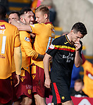 Ryan Bowman celebrates his goal for Motherwell as Partick's Paul McGinn looks dejected