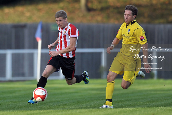 Lewis Smith (Hornchurch) goes past Ross Parmenter (Wingate). AFC Hornchurch Vs Wingate and Finchley. Ryman Premier League. The Stadium. Essex. 01/10/2011. MANDATORY Credit Sportinpictures/Garry Bowden - NO UNAUTHORISED USE - 07837 394578.