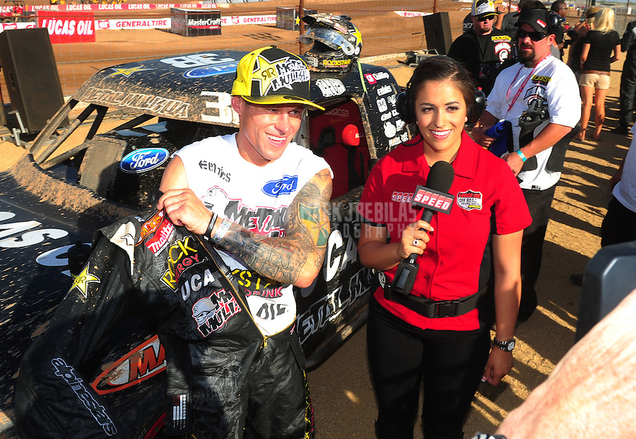 Apr 16, 2011; Surprise, AZ USA; LOORRS driver Brian Deegan (left) is interviewed by Keli Snyder during round 3 at Speedworld Off Road Park. Mandatory Credit: Mark J. Rebilas-.