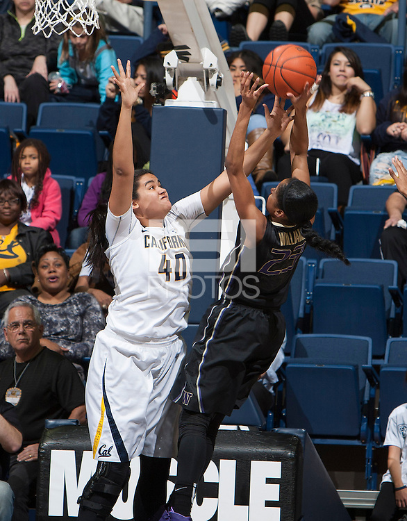 Justine Hartman of California blocks the ball during the game against Washington at Haas Pavilion in Berkeley, California on March 1st, 2014.   Washington defeated California, 70-65.