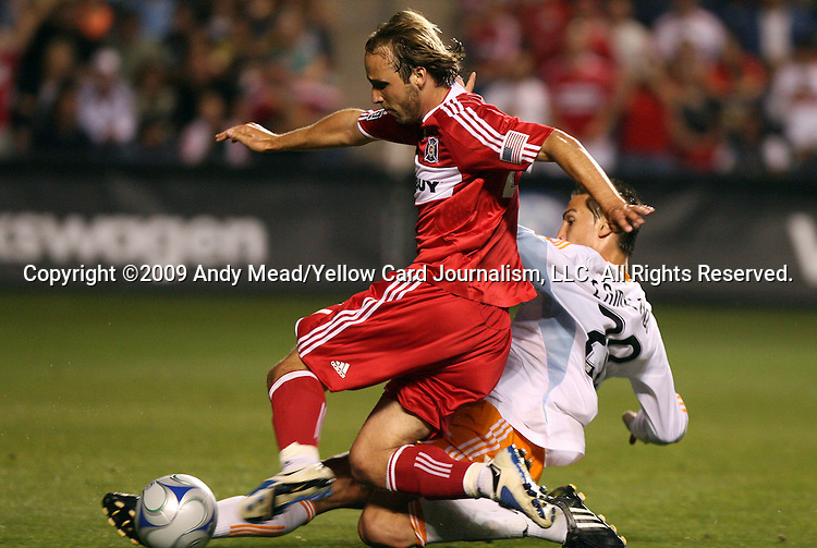 05 June 2009: Houston's Geoff Cameron (20) tackles the ball away from Chicago's Justin Mapp (in red). The Houston Dynamo defeated the Chicago Fire 1-0 at Toyota Park in Bridgeview, Illinois in a regular season Major League Soccer game.