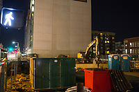 An empty lot and construction equipment stand next to a high-rise building on Boylston street in the Fenway neighborhood of Boston, Massachusetts, USA, in the early hours of Saturday, Dec. 5, 2015.