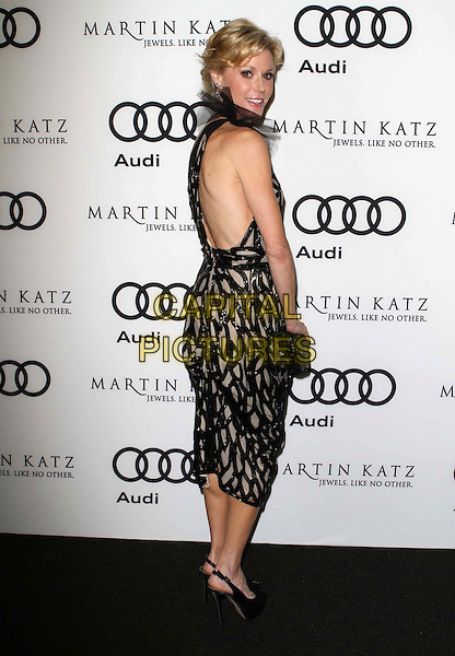 Julie Bowen.Audi And Martin Katz Kick Off Golden Globes Week 2012 Held At Cecconi's Restaurant, West Hollywood, California, USA..January 8th, 2012.full length dress black lace one shoulder clutch bag print sheer side backless looking over shoulder .CAP/ADM/KB.©Kevan Brooks/AdMedia/Capital Pictures.