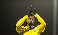 Gozie Ugwu of Wycombe Wanderers  applauds the support during the Sky Bet League 2 match between Dagenham and Redbridge and Wycombe Wanderers at the London Borough of Barking and Dagenham Stadium, London, England on 9 February 2016. Photo by Andy Rowland.