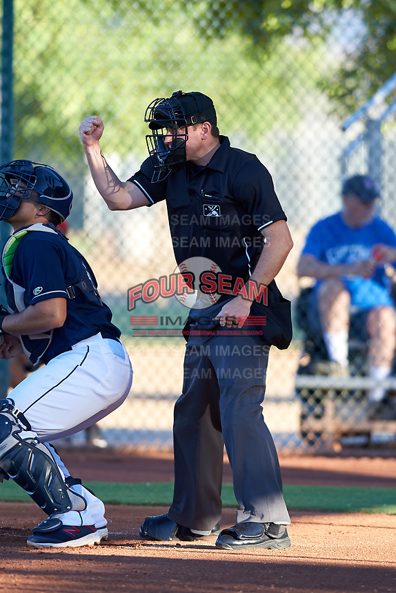 Home plate umpire Tyler Wall calls a strike during an Arizona League game between the AZL Padres 1 and AZL Indians Red on June 23, 2019 at the Cleveland Indians Training Complex in Goodyear, Arizona. AZL Indians Red defeated the AZL Padres 1 3-2. (Zachary Lucy/Four Seam Images)