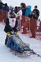 Rick Larson team leaves the start line during the restart day of Iditarod 2009 in Willow, Alaska