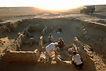 Archaeologist Victor Sarianidi oversees cart excavation in royal tomb; Oxus Civilization; Turkmenistan; Gonor Depe site; Victor Sarianidi; Archaeology; BMAC complex