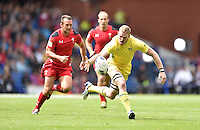 Australia's Tom Cusack looks to get away from Wales's Gareth Davies<br /> <br /> Australia Vs Wales - Men's quarter-final<br /> <br /> Photographer Chris Vaughan/CameraSport<br /> <br /> 20th Commonwealth Games - Day 4 - Sunday 27th July 2014 - Rugby Sevens - Ibrox Stadium - Glasgow - UK<br /> <br /> © CameraSport - 43 Linden Ave. Countesthorpe. Leicester. England. LE8 5PG - Tel: +44 (0) 116 277 4147 - admin@camerasport.com - www.camerasport.com