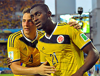 CUIABA - BRASIL -24-06-2014. Jackson Martinez (#21) y Santiago Arias (#4) jugadores de Colombia (COL) celebran un gol anotado a Japón (JPN) durante partido del Grupo C de la Copa Mundial de la FIFA Brasil 2014 jugado en el estadio Arena Pantanal de Cuiaba./ Jackson Martinez (#21) and Santiago Arias (#4) players of Colombia (COL) celebrate a goal scored to Japan (JPN) during the macth of the Group C of the 2014 FIFA World Cup Brazil played at Arena Pantanal stadium in Cuiaba. Photo: VizzorImage / Alfredo Gutiérrez / Contribuidor