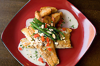 Almond crusted Halibut with green beans, almonds, potatoes and tomatoes.