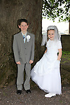 Adam Stanley and Mercedes Stanley cousins at First Communion in Donore Church..Photo: Fran Caffrey/www.newsfile.ie..