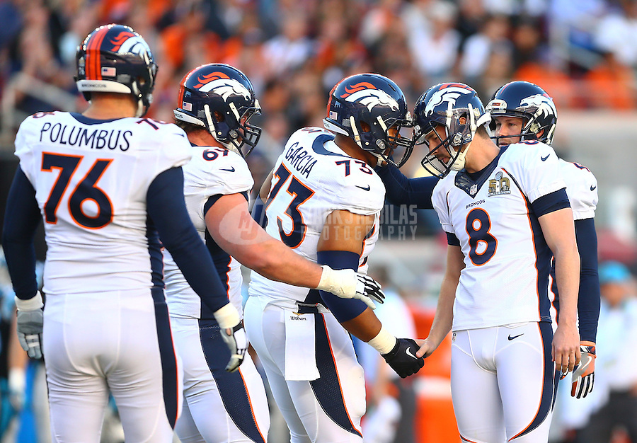 Feb 7, 2016; Santa Clara, CA, USA; Denver Broncos kicker Brandon McManus (8) celebrates with center Max Garcia (73) and teammates after a field goal against the Carolina Panthers in Super Bowl 50 at Levi's Stadium. Mandatory Credit: Mark J. Rebilas-USA TODAY Sports