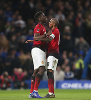 Manchester United's Paul Pogba celebrates scoring his side's second goal with Ashley Young<br /> <br /> Photographer Rob Newell/CameraSport<br /> <br /> Emirates FA Cup Fifth Round - Chelsea v Manchester United - Monday 18th February - Stamford Bridge - London<br />  <br /> World Copyright © 2019 CameraSport. All rights reserved. 43 Linden Ave. Countesthorpe. Leicester. England. LE8 5PG - Tel: +44 (0) 116 277 4147 - admin@camerasport.com - www.camerasport.com