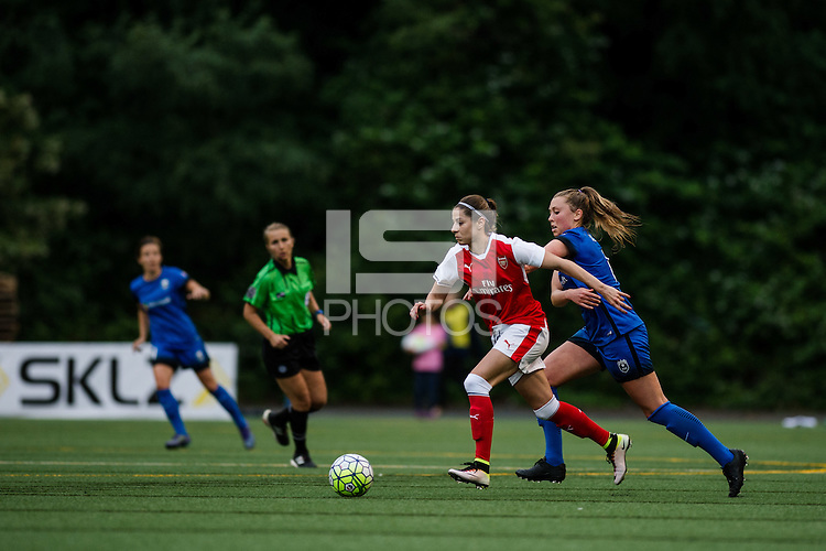 Seattle, WA - Thursday, May 26, 2016: Vicky Losada (6) of the Arsenal Ladies FC  is marked by Seattle Reign FC midfielder Lindsay Elston (6). The Seattle Reign FC of the National Women's Soccer League (NWSL) and the Arsenal Ladies FC of the Women's Super League (FA WSL) played to a 1-1 tie during an international friendly at Memorial Stadium.
