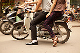 VIETNAM, Hanoi, a detail of a couple driving a moped through town wearing fancy shoes