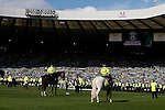 Fans and police on the pitch after the William Hill Scottish Cup Final match at Hampden Park Stadium.  Photo credit should read: Lynne Cameron/Sportimage